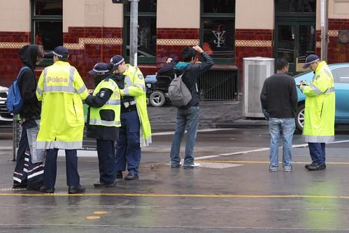 Police book jaywalkers outside Flinders Street Station